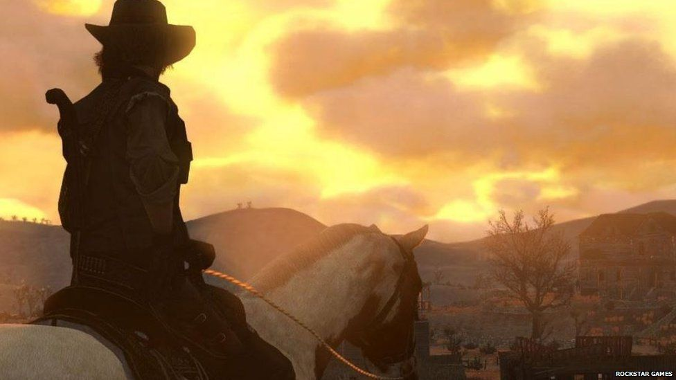 John Marston overlooks a town in Red Dead Redemption
