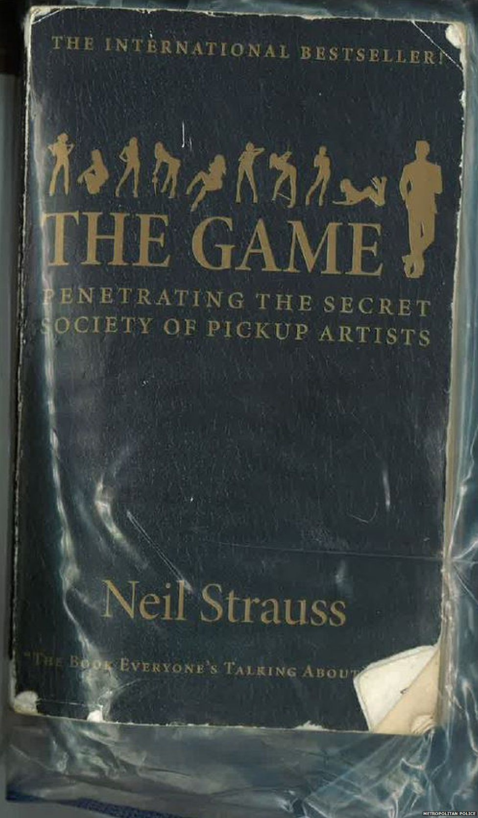 A copy of the book The Game found at Ojo's address