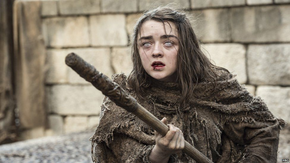 Arya Stark with a stick