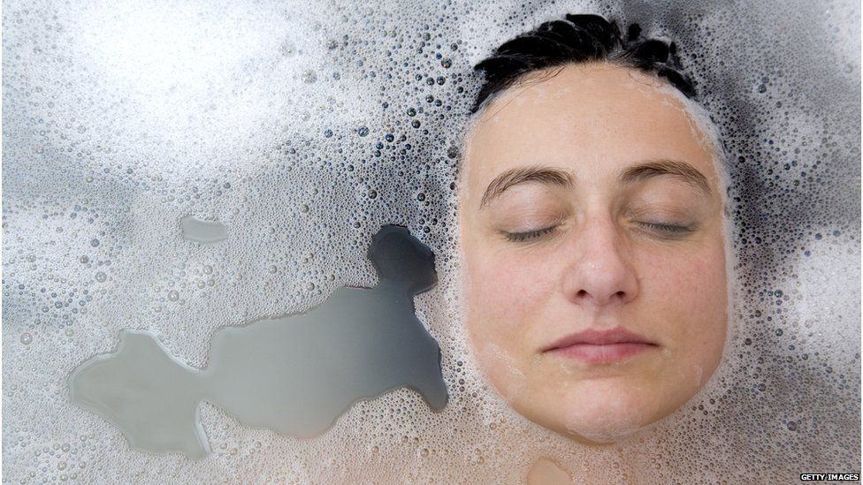 A woman's face in the bath