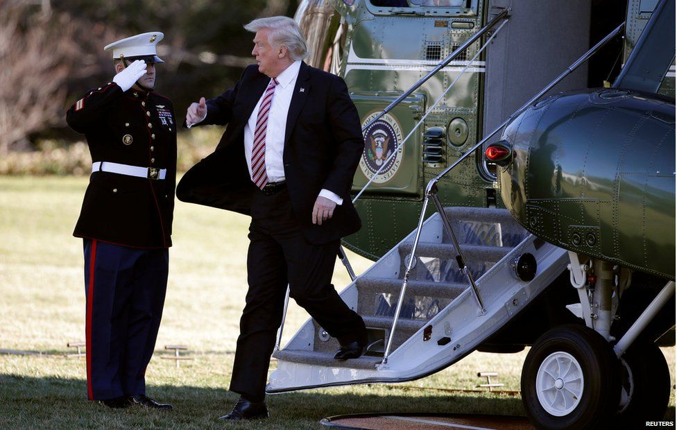 Donald Trump exiting a helicopter down some stairs