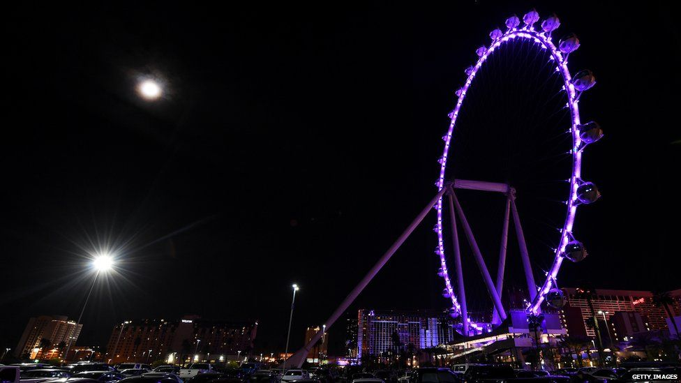 The High Roller at The LINQ Promenade on the Las Vegas Strip is lit up purple