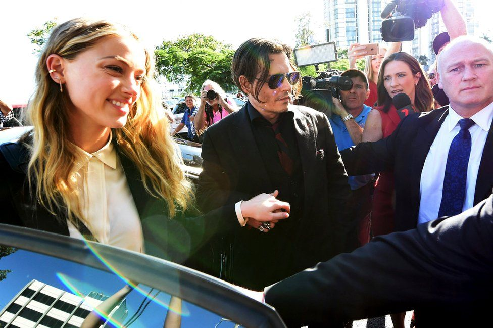 US actor Johnny Depp (second from right) and his wife, US actress Amber Heard arrive at Southport Magistrates Court on the Gold Coast, Australia