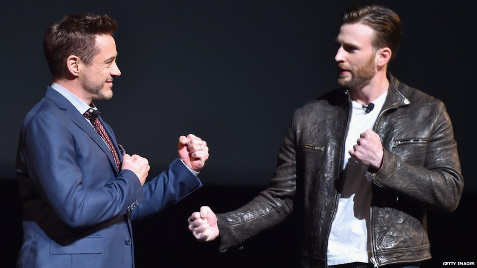 Robert Downey Jr. and Chris Evans, who play Iron Man and Captain America, jokingly pretend to fight each other at a fan event last October