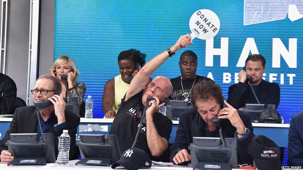 Bruce Willis, Al Pacino, Tracy Morgan and Leonardo Di Caprio take calls at the telethon in Los Angeles