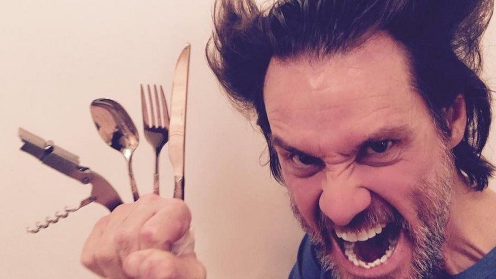 jim carrey does wolverine using cutlery in response to hugh jackman