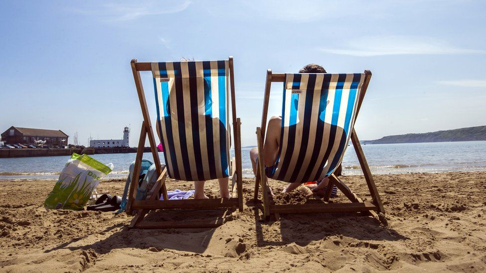 People enjoy the hot weather on the beach in Scarborough, North Yorkshire