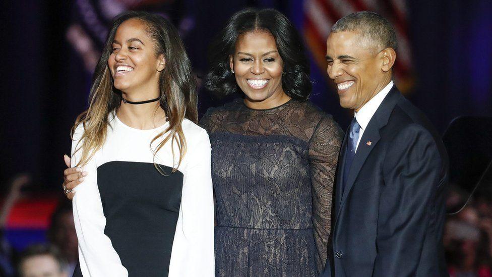 Malia, Michelle and Barack Obama