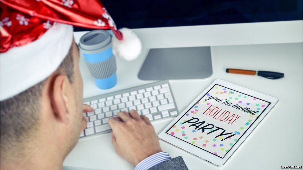 Man at his desk with party invite