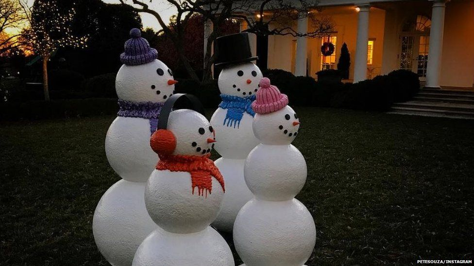 snowmen in the rose garden