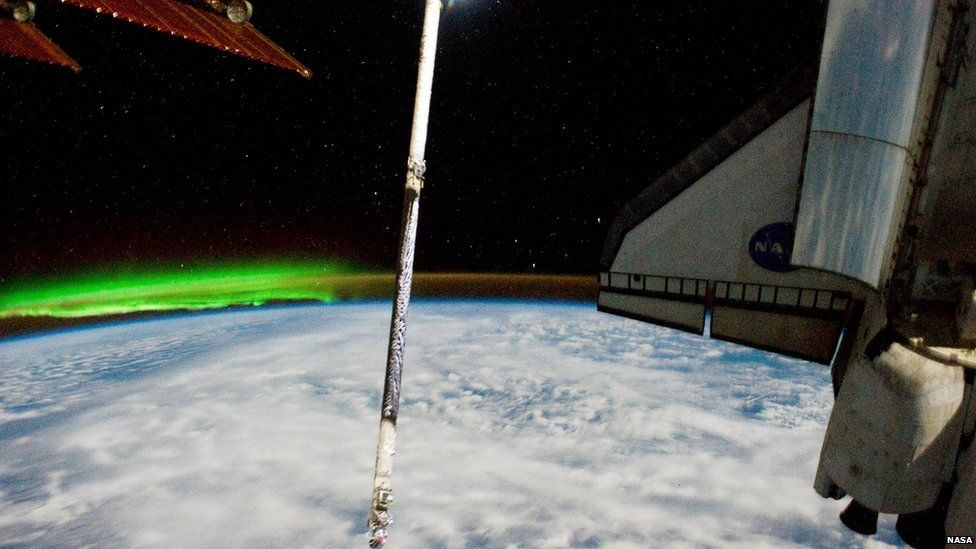 Atlantis docked with the ISS and the southern lights