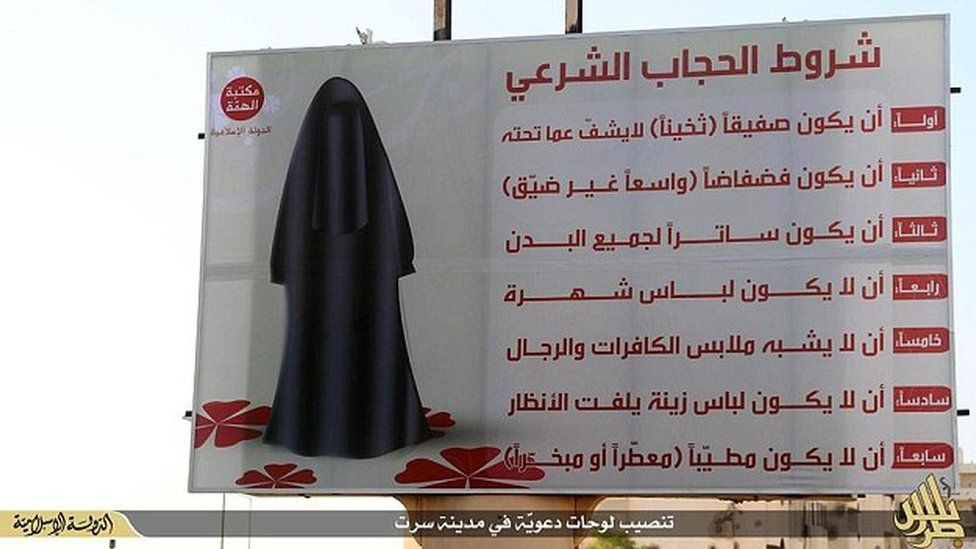 Image published by IS that the group says shows a billboard instructing women how to dress in Sirte