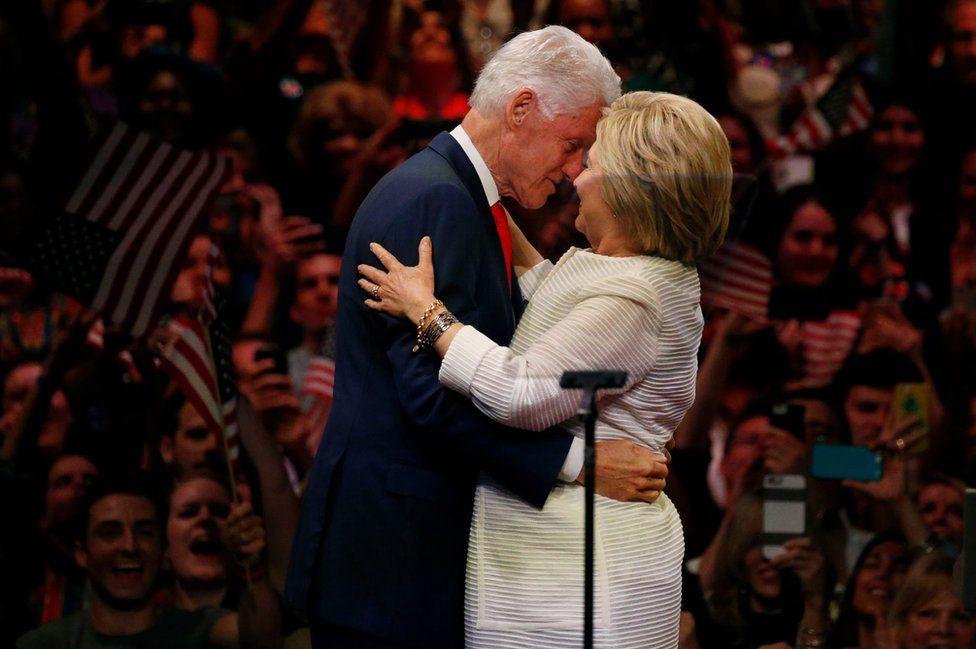 Democratic US presidential candidate Hillary Clinton hugs her husband former President Bill Clinton
