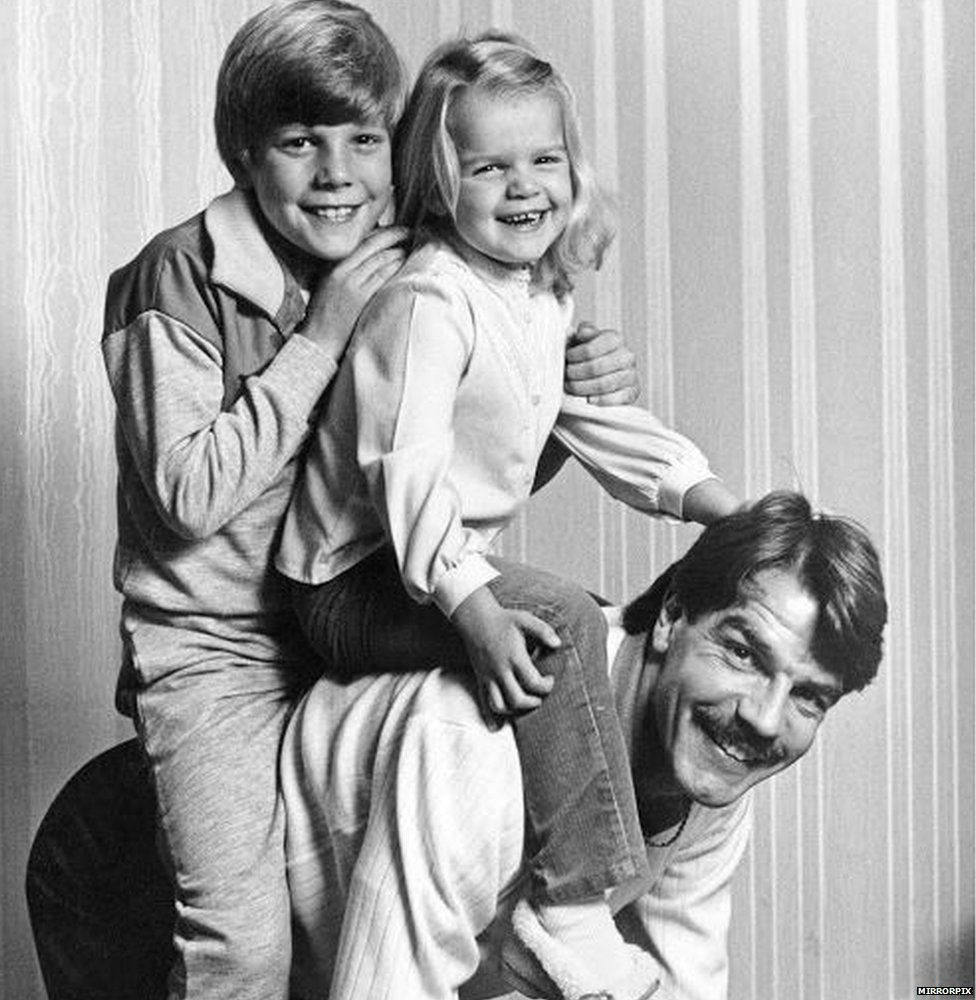 Sam Allardyce with his young kids on his back
