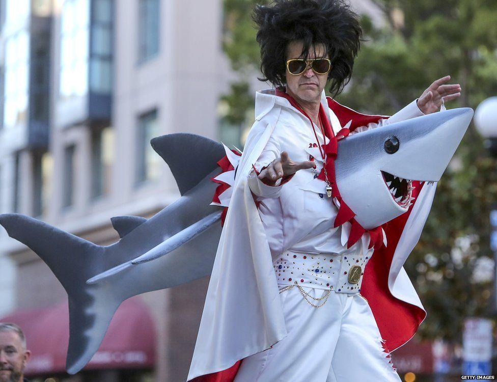 An Elvis impersonator performs on stilt