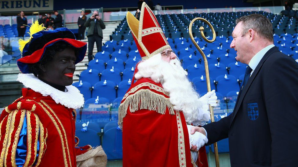 This is a photo of Saint Nicholas and the figure of Black Pete.