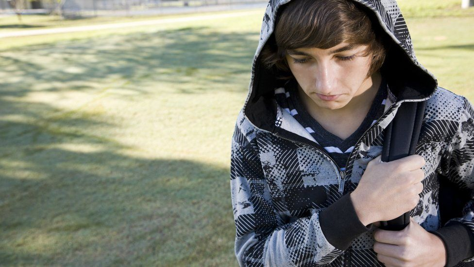 Teenage child in a park
