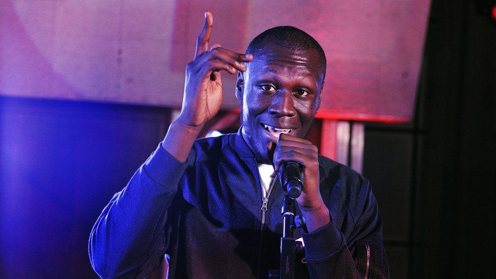 Stormzy performing on stage