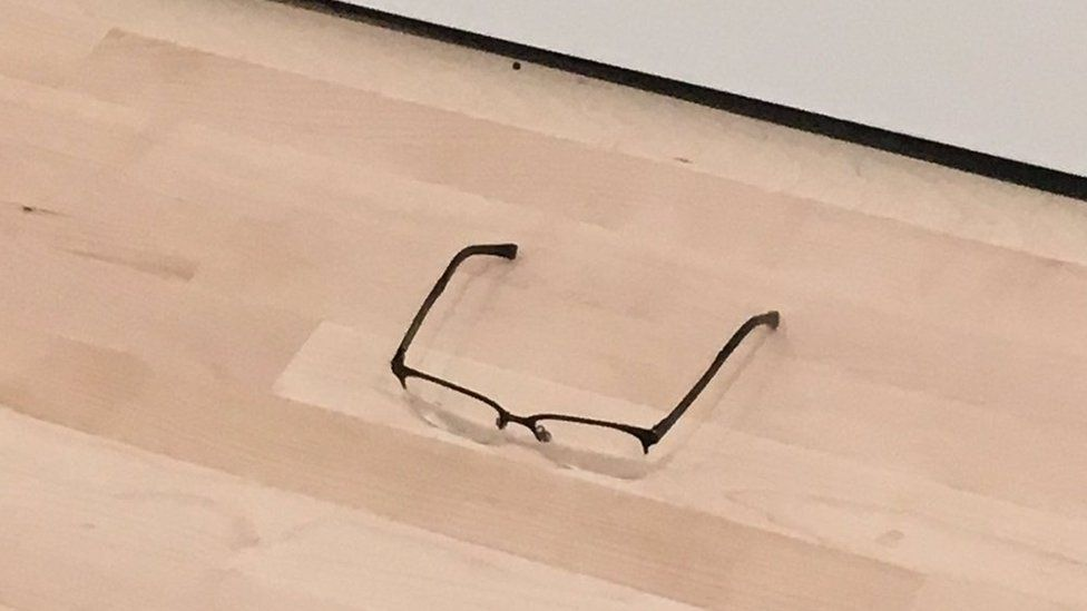 The glasses on the floor of the gallery