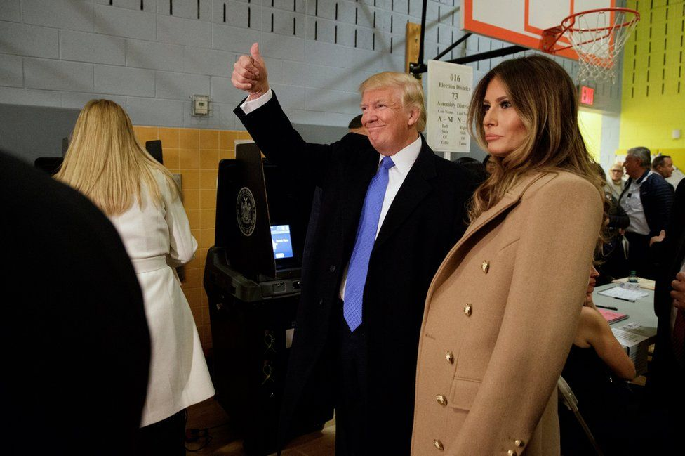 Republican presidential candidate Donald Trump, accompanied by his wife Melania in New York