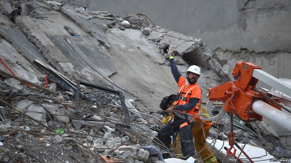 A rescue worker calls for help