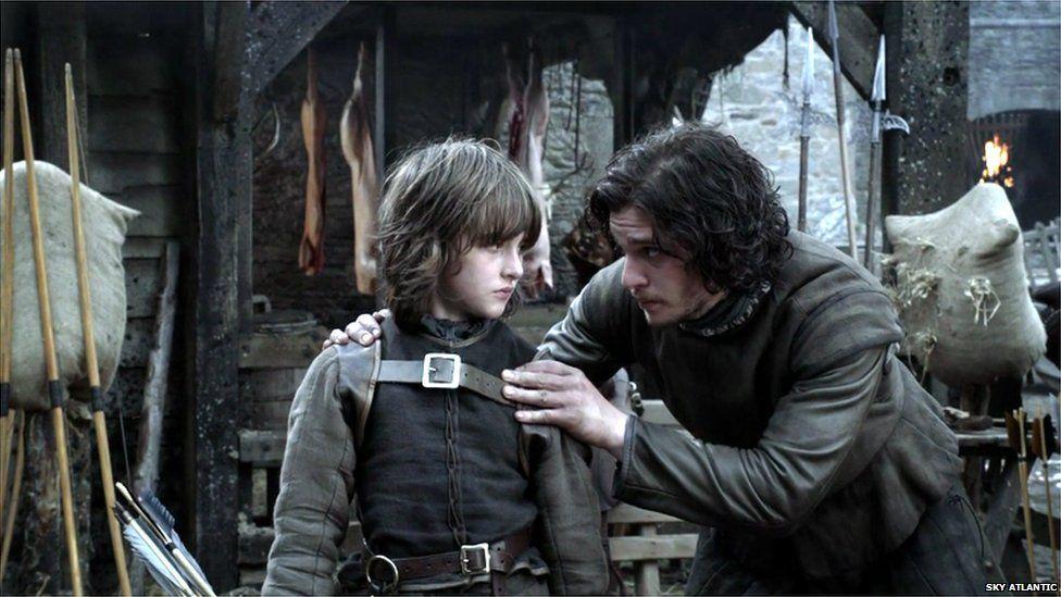 Isaac Hempstead-Wright as Bran Stark and Kit Harrington as Jon Snow