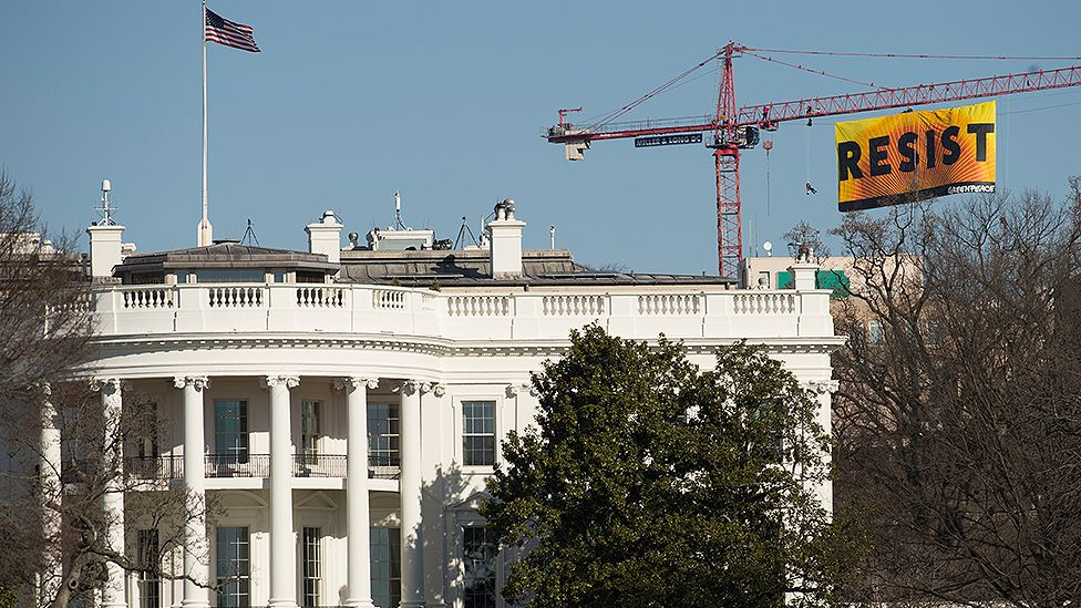 Greenpeace protesters 'resist' Trump, climb crane in northwest DC
