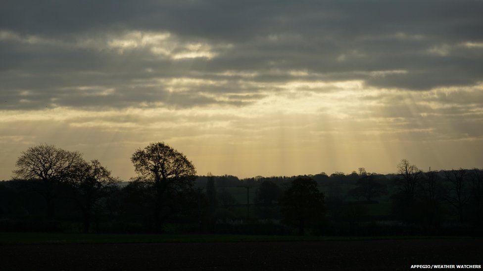 Sun beams through cloud
