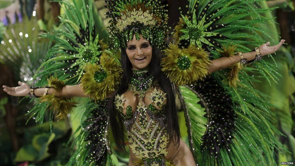 A reveller from the Rocinha samba school dances as she takes part in the Group A category of the annual Carnival parade in Rio de Janeiro's Sambadrome, Brazil