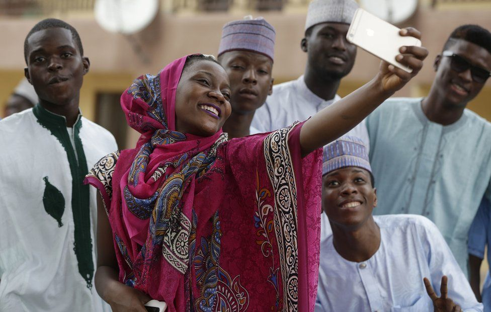 A Nigeria woman taking photograph after Eid al-Adha at the prayer ground in Lagos, Nigeria, Monday 12 September 2016
