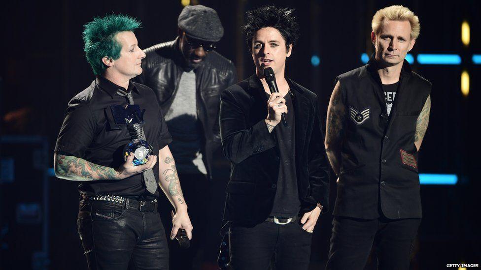 Image caption Idris Elba presented Green Day s MTV EMA award to the band.
