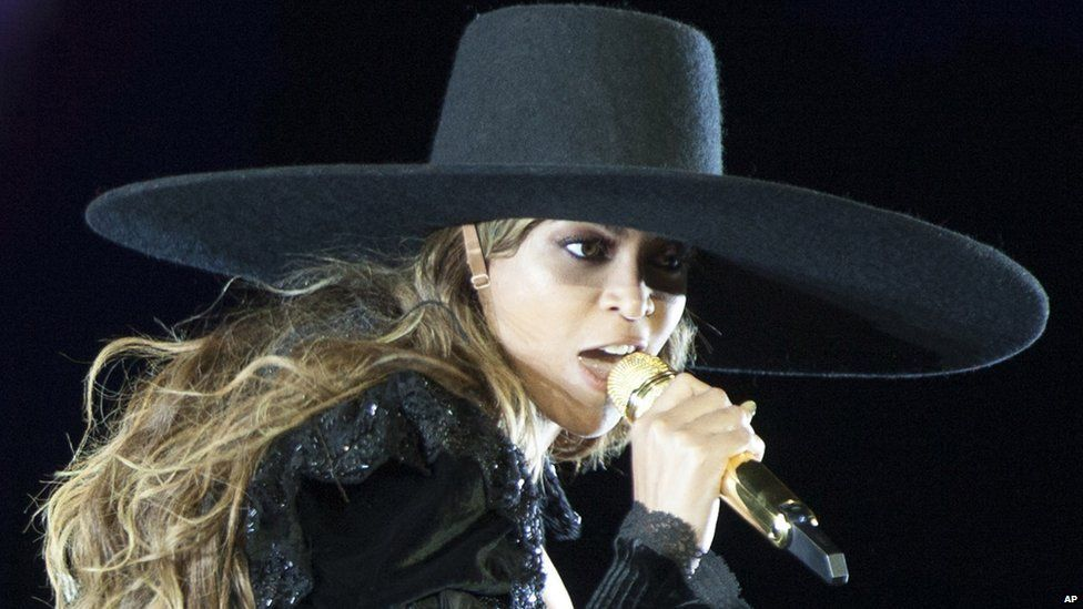 Beyonce wearing a big hat