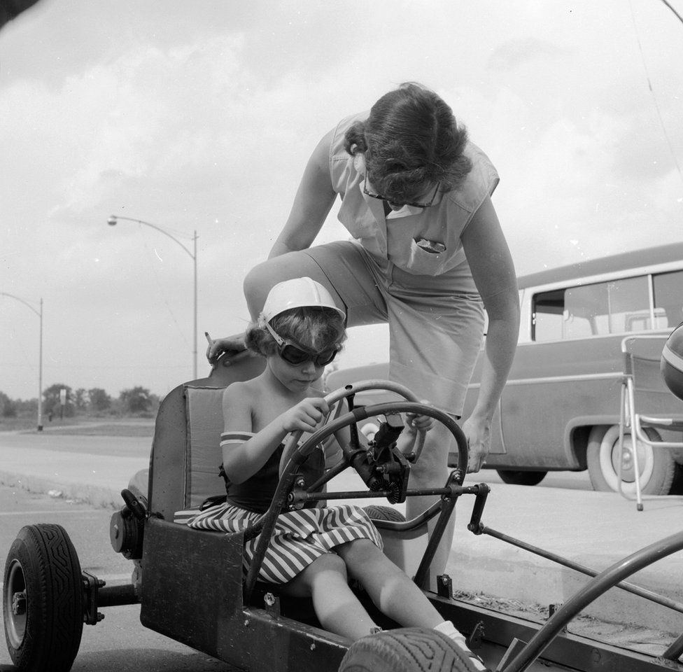 boy and mum with car