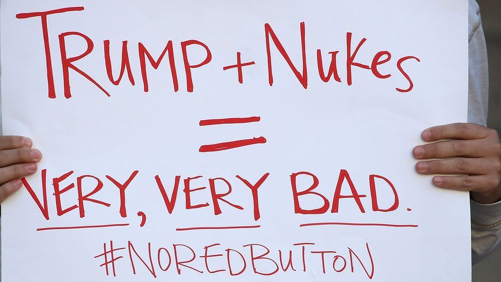 Protestor holding up sign about nuclear weapons