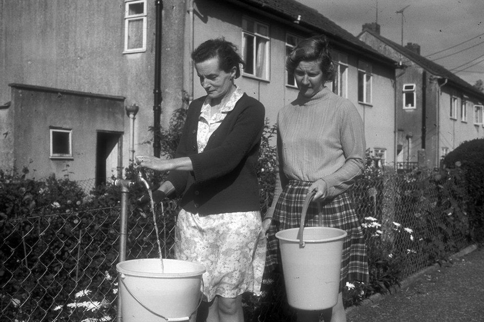 Women use a standpipe in August 1976