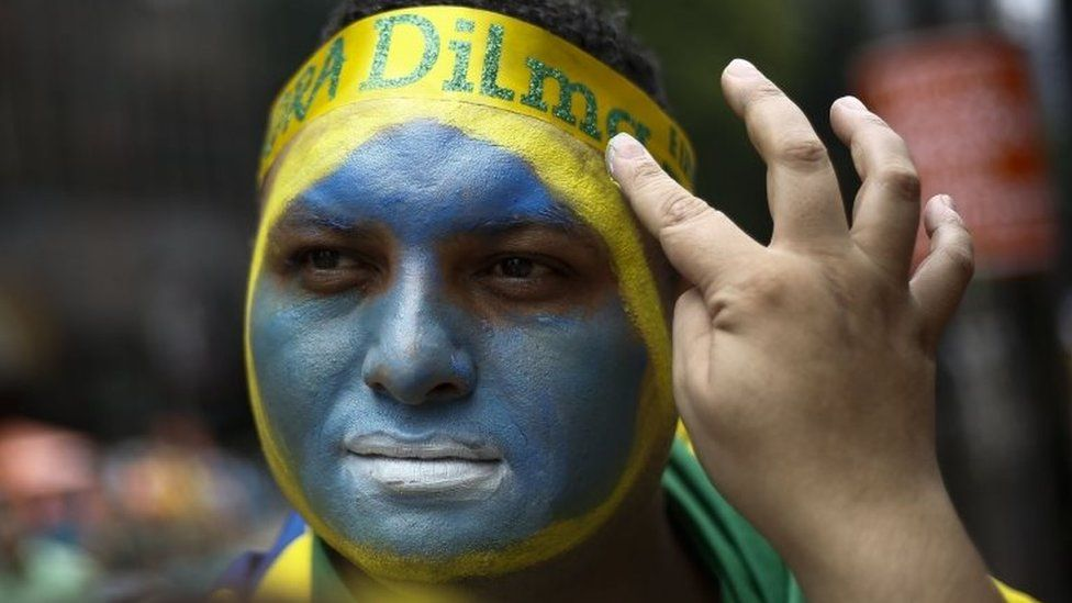 Demonstrators paint their faces during a protest to demand the resignation of Brazilian President Dilma Rousseff, on March 13, 2016 in Sao Paulo.