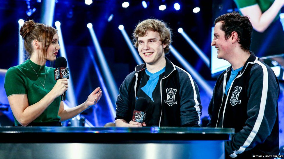 Members of team Origen get interviewed after booking their place in the quarter finals