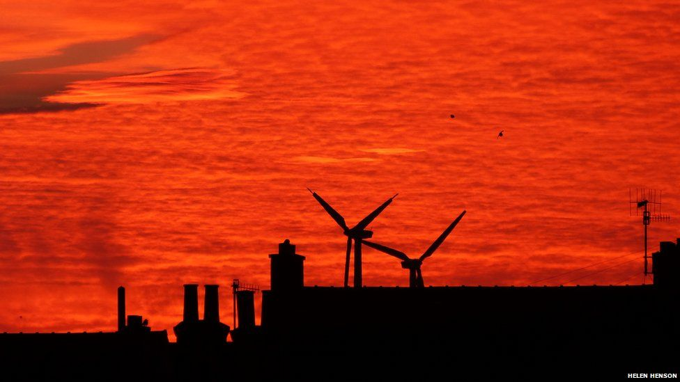 A red sunrise over rooftops