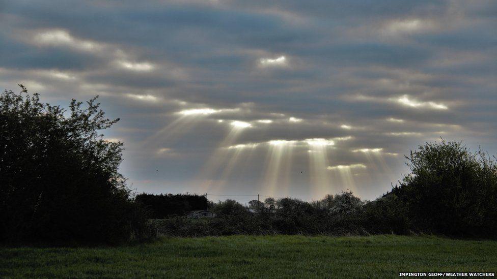Beams of sunlight through cloud