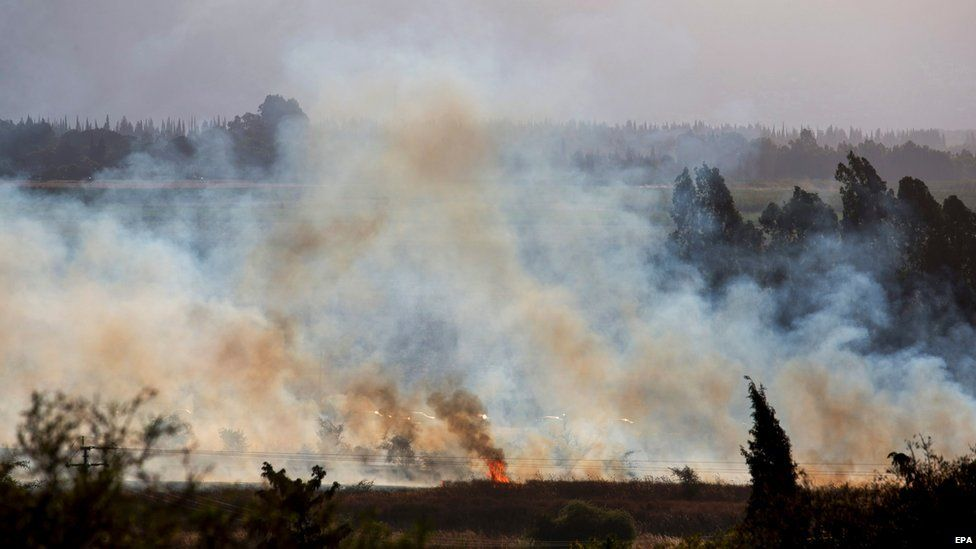 Kfar Szold Israel  city photos gallery : fire near Kfar Sold, north of Israel, caused by four missiles fired ...