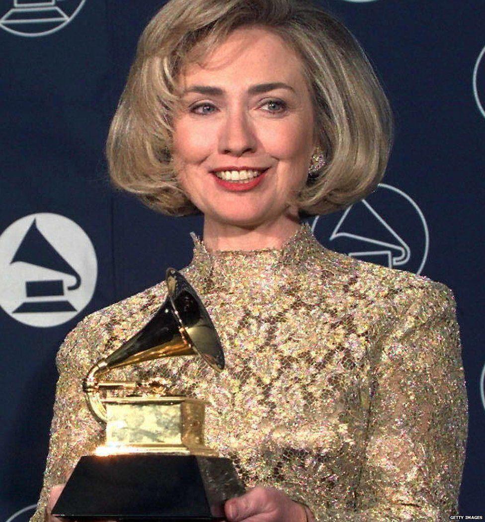 Hillary Clinton holding her Grammy award