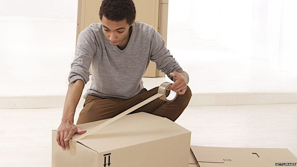 Man packing a box