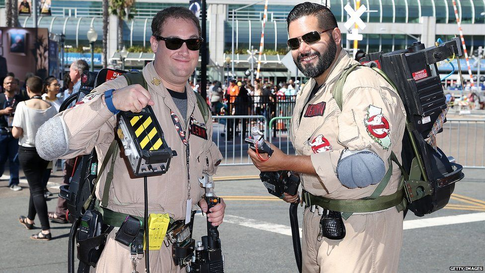 Two Comic-Con fans dressed as the original members of Ghostbusters.