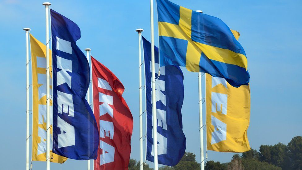 This is a photo of the signature IKEA flags that are raised outside of their UK stores.