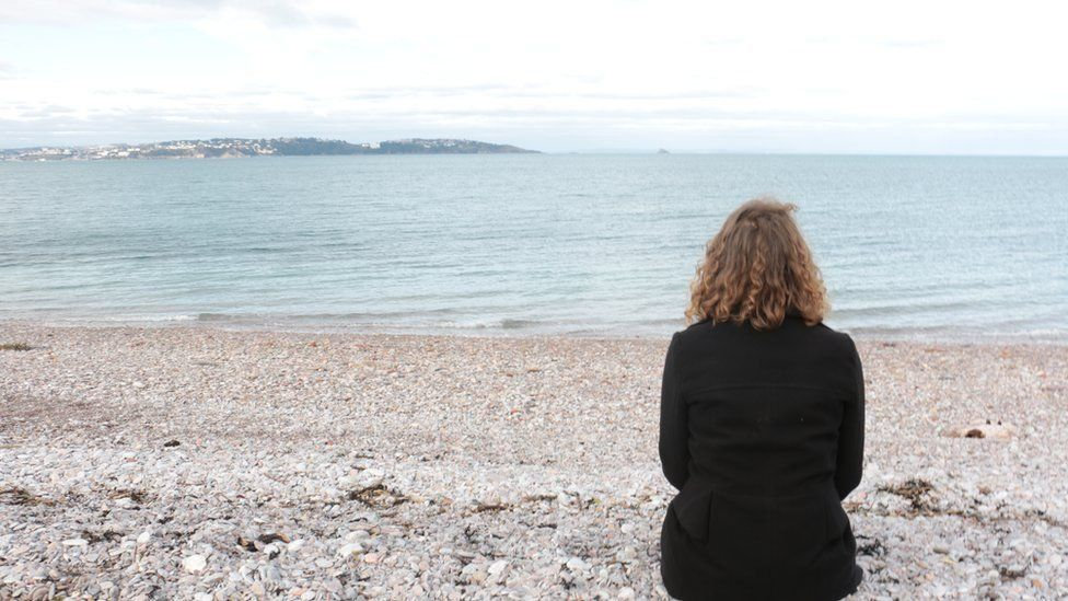 Gabbi sat on the beach