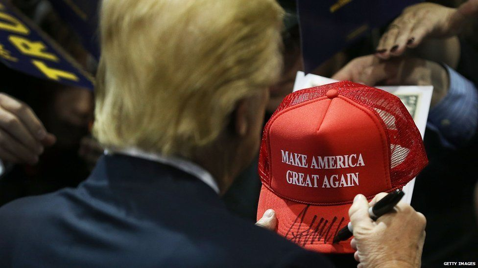 """This is a photo of Donald Trump's campaign merchandise. The red hat reads, """"Make America great again."""""""