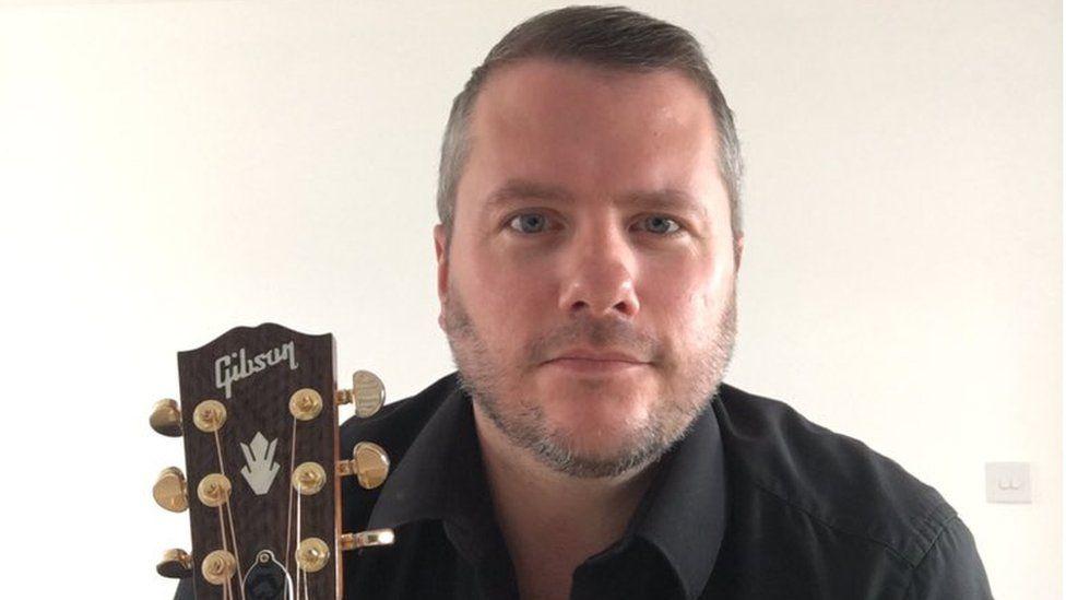 Guitar teacher Andrew Mackin