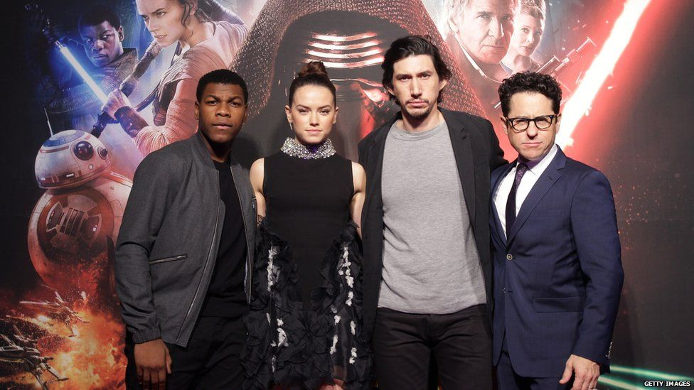 (L to R) Actor John Boyega, actress Daisy Ridley, actor Adam Driver and director JJ Abrams