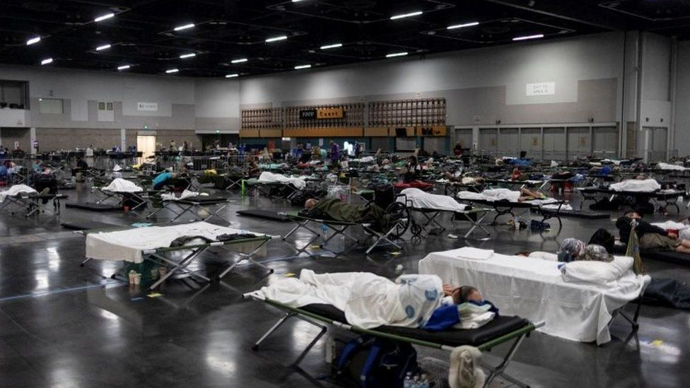 People sleep at a cooling centre set up in Portland in the US state of Oregon
