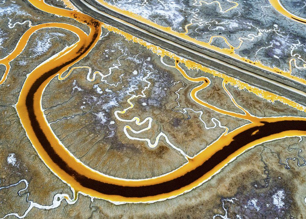 An aerial view of the bright colours of San Francisco salt mines